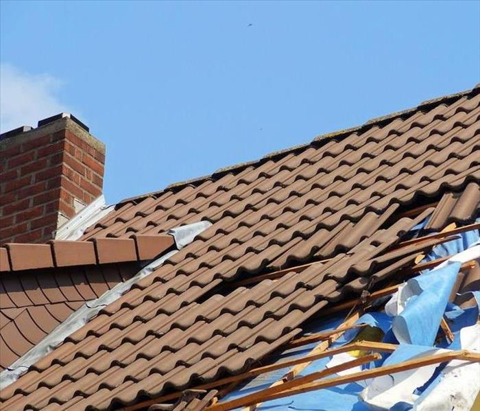 Tile roof shingles damaged by a storm.