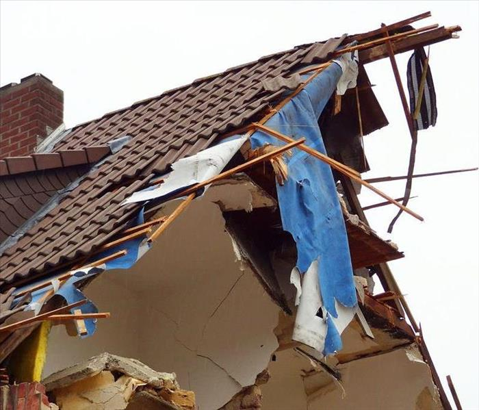 Home roof destroyed by strong winds.